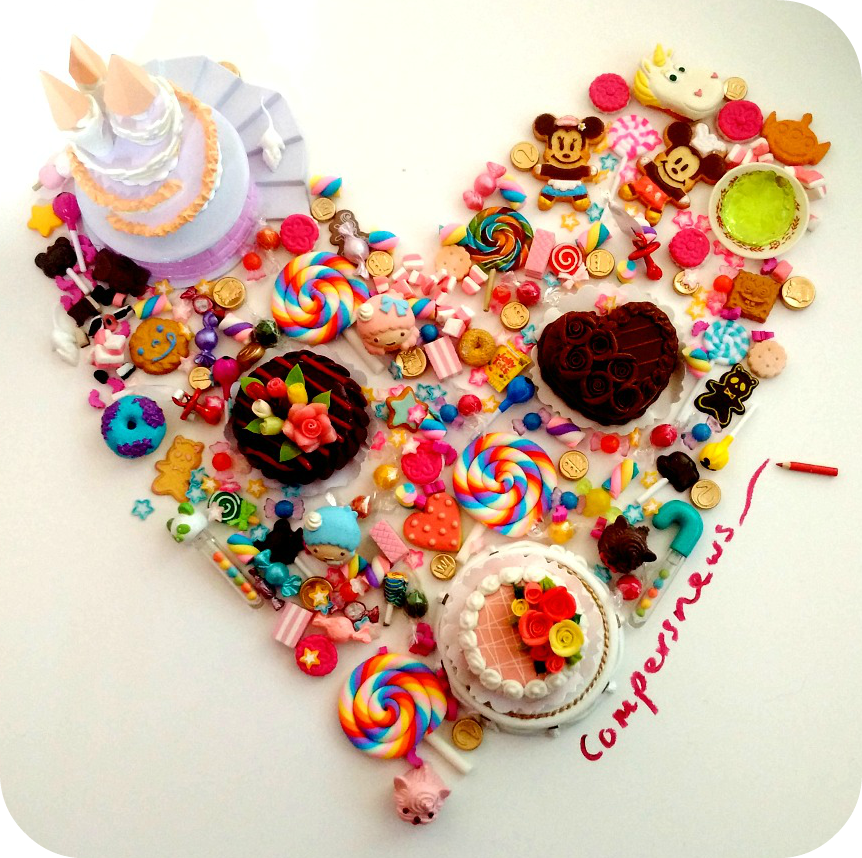 Heart made of miniature sweets and cakes