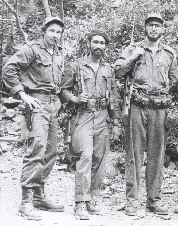 FIDEL CASTRO (far right), with his brother RAUL CASTRO (far left), and JUAN ALMEIDA (center), know as 'Cuban Rebels', c. 1959