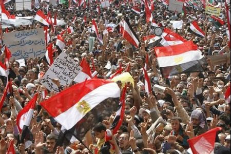 Thousands of Eyptians hold an anti-zionist and anti-US demonstration in Cairo on April 8, 2011. The demonstration demanded the re-opening of the border with Gaza and tried to take the Israeli flag from the embassy to replace it with a Palestine one. by Pan-African News Wire File Photos