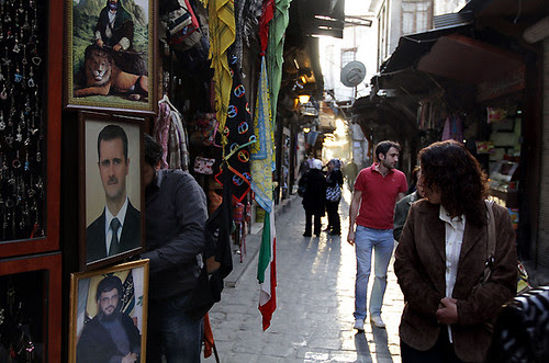 Syrian President Bashir al-Assad in portrait with Nasrallah of Lebanon beneath. Assad is saying he will not leave office in the face of imperialist intervention. by Pan-African News Wire File Photos