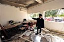 A policeman stands inside an office of a police station after a bomb explosion in Benghazi