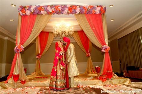 Indian wedding ceremony fabric mandap floral decor   Photo
