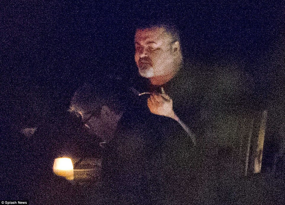 These are among the last pictures taken of George Michael dining with friends at an Oxfordshire restaurant in September