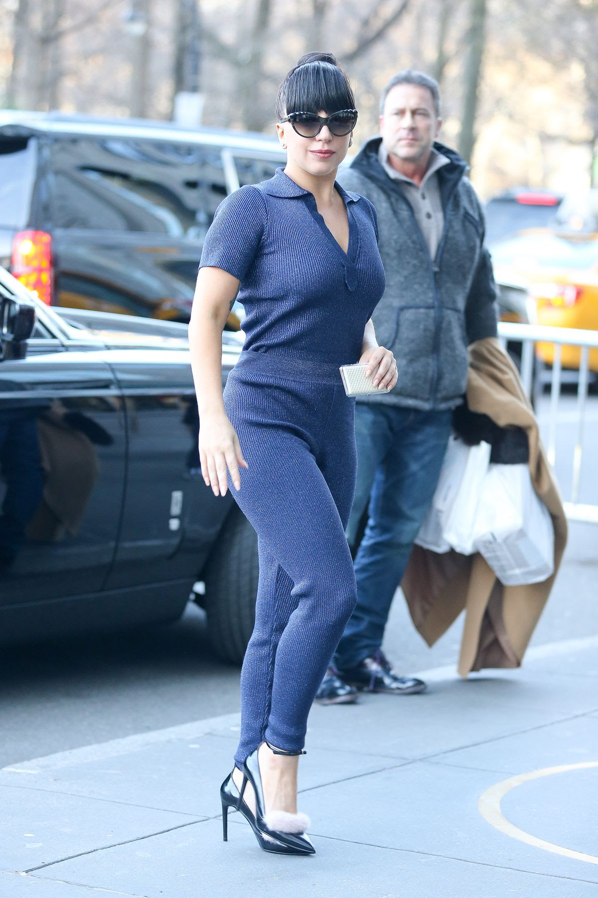 Lady Gaga wears a blue outfit and a furry pumps while arriving at her apartment in New York City