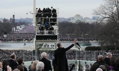 Barack Obama waves to crowds.