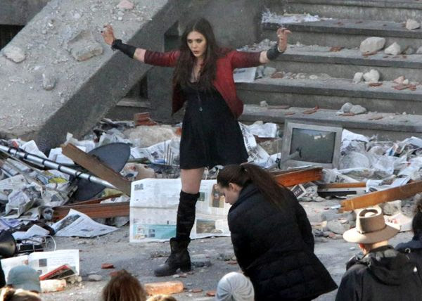Elizabeth Olsen in action as Scarlet Witch on the set of AVENGERS: AGE OF ULTRON.