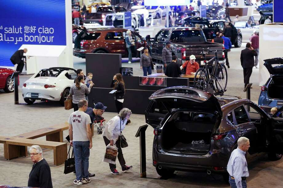 People browse through the Mazda display space during the first day of the Houston Auto Show at NRG Center Wednesday, Jan. 24, 2018 in Houston. ( Michael Ciaglo / Houston Chronicle) Photo: Michael Ciaglo, Houston Chronicle / Michael Ciaglo