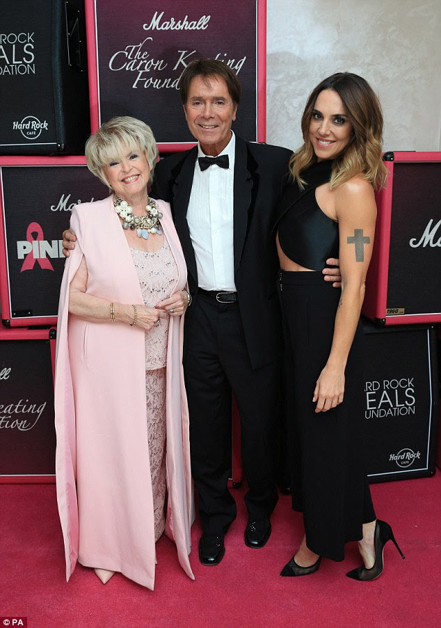 Cheery mood: Cliff Richard appeared to be putting his troubles behind him as he parties with Mel C and Gloria Hunniford at the Pinktober event in London on Friday