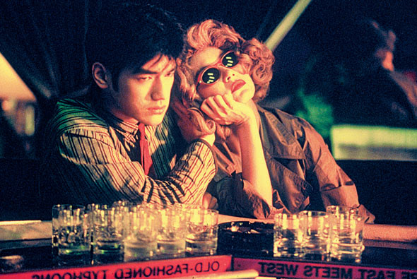 Chungking Express movie scenes  no opinions or ideas upon the viewer The two stories are simply told and are told simply leaving us to extract our personal meaning from the strange