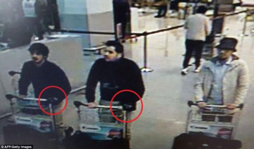 First picture: These three men, pretending to be air passengers, are believed to the terrorists who have carried out the Brussels airport. The two suspected suicide bombers on the left were both wearing black gloves - which the Belgian media says  would have hidden the triggers for their explosive vests. The third suspect in the hat is believed to still be on the run after dropping his nail bomb
