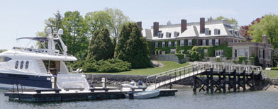 The back of a historic mansion is seen from the harbor in Cohasset, Mass. (AP Photo/Charles Krupa)