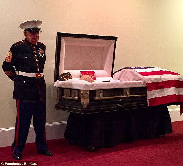 Honor: Retired Marine Master Sgt. William H. Cox (left) kept his promise to stand guard at his friend's funeral, Retired Marine First Sgt. James 'Hollie' Hollingsworth on October 24