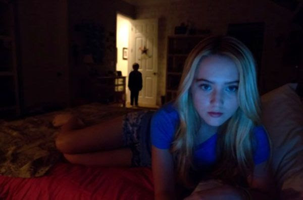 Alex (Kathryn Newton) is unaware that a demon child is standing at the door of her bedroom in PARANORMAL ACTIVITY 4.