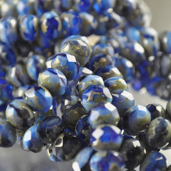 s35934 Firepolish - 8 x 6 mm Faceted Donut - Azure Storm (strand 25)