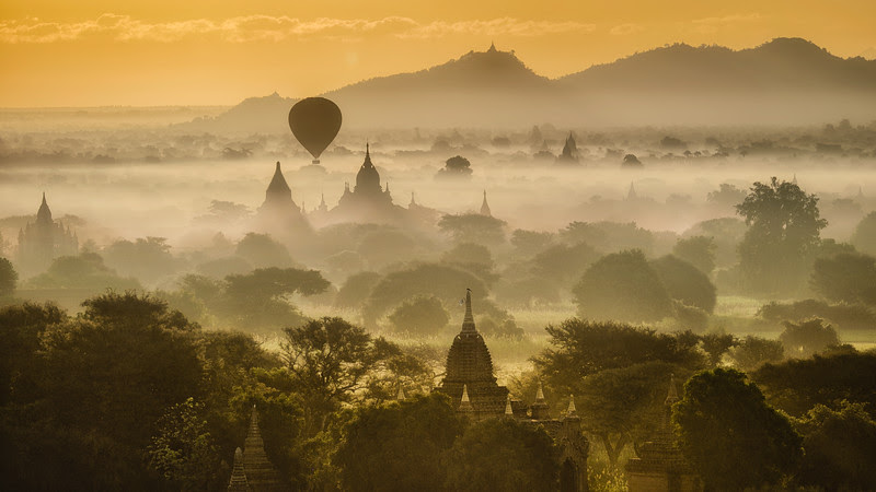 Balloon over misty Bagan at sunset