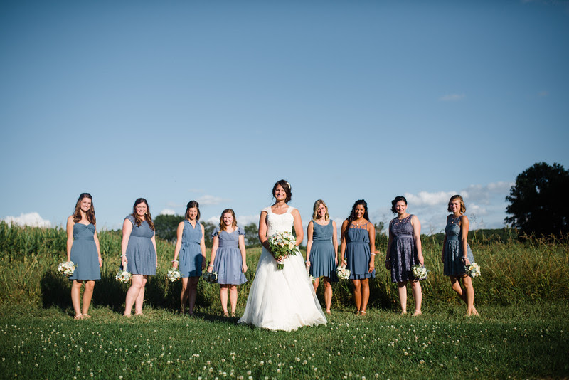Bride ad bridesmaids take fun portraits at Busy Barns Adventure farms in Fort Atkinson Wisconsin about 30 minutes east of Madison and an hour north of Chicago. Photo by Mindy Joy Photography.