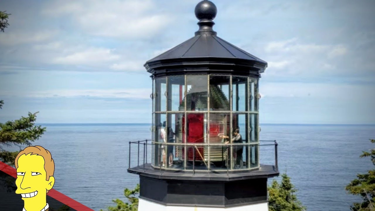 Cape Meares lighthouse in front of views of Oregon Coast
