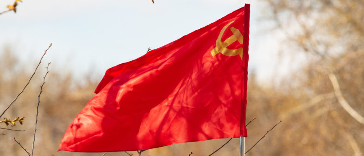 Featured is the red, sickle-hammer banner of the Soviet Union. (Shutterstock/kzww)