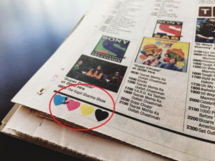 Colour dots in the newspaper mean