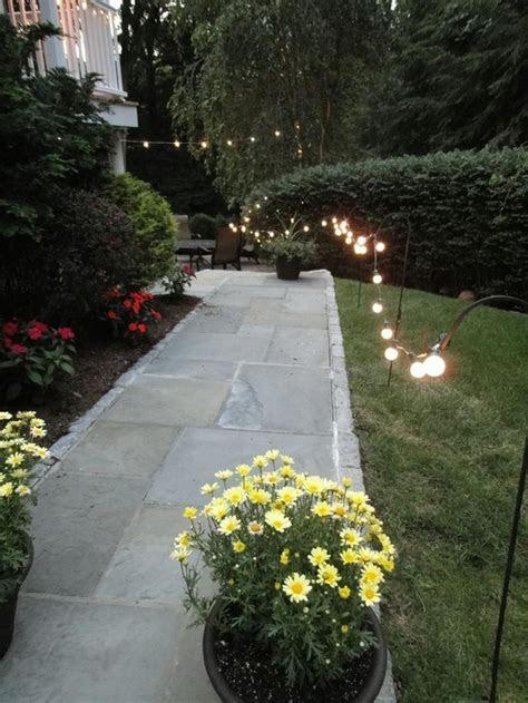 string lights on shepherds hooks   www.MLEvents.us