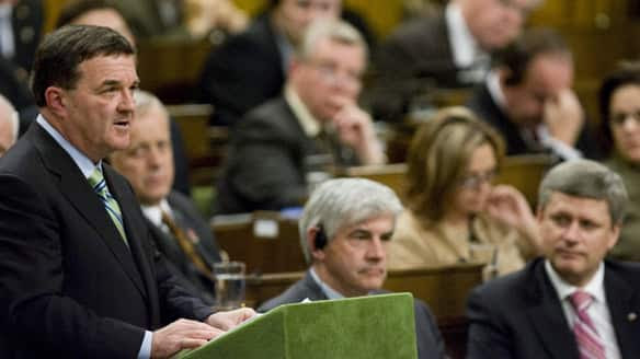 Prime Minister Stephen Harper, far right, watches as Finance Minister Jim Flaherty delivers the government's fiscal update in the House of Commons on Nov. 27.