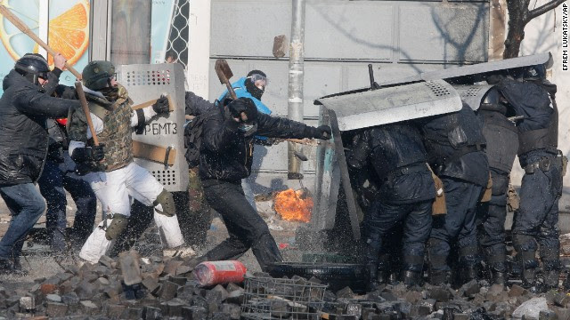 Anti-government protesters clash with riot police outside Ukraine's parliament in Kiev on February 18.