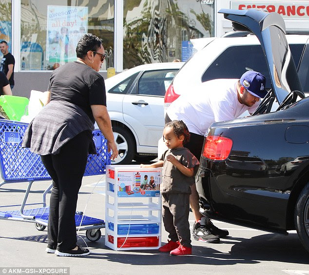 Gentleman: Rob helped load all the toys into the back of the car before driving away.