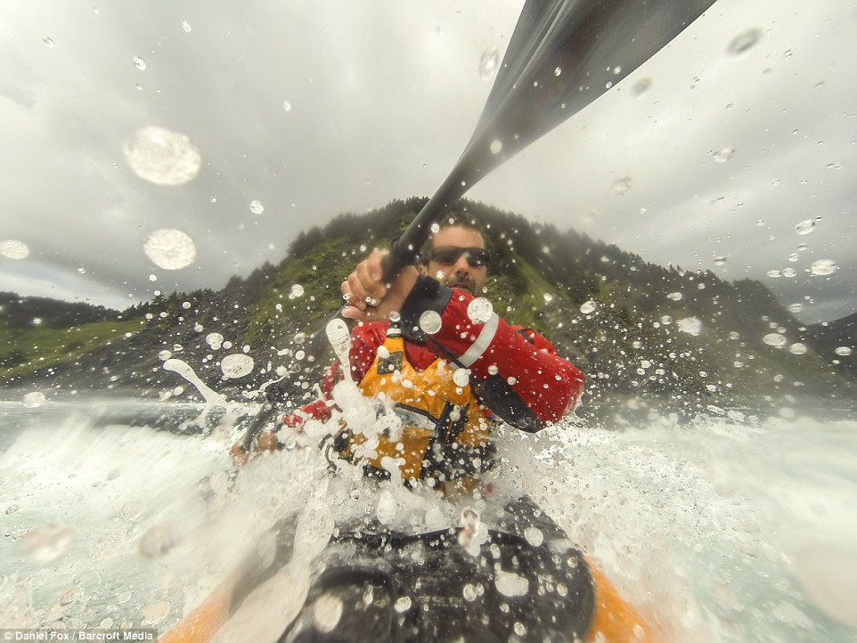 Daniel Fox splashes water into the camera as he kayaks around the stunning scenery in June this year in Afognak Island, Alaska