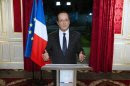 France's President Hollande arrives to deliver his New Year's speech at the Elysee Palace in Paris