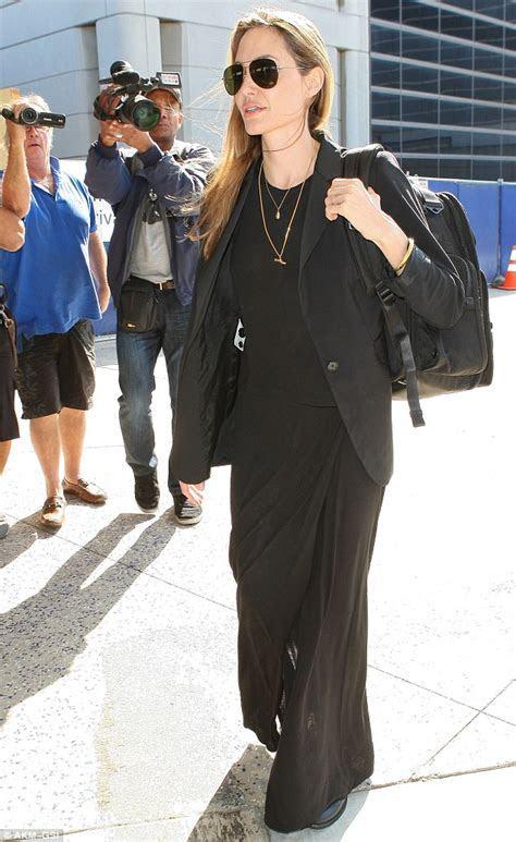 Angelina Jolie's gold band is Brad Pitt's great