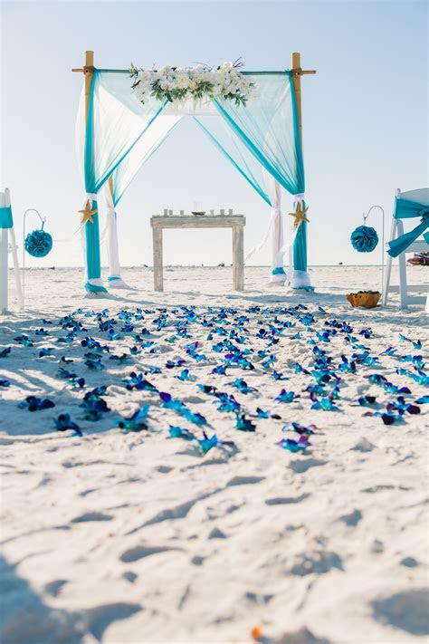 Turquoise beach wedding with blue bom orchid aisle