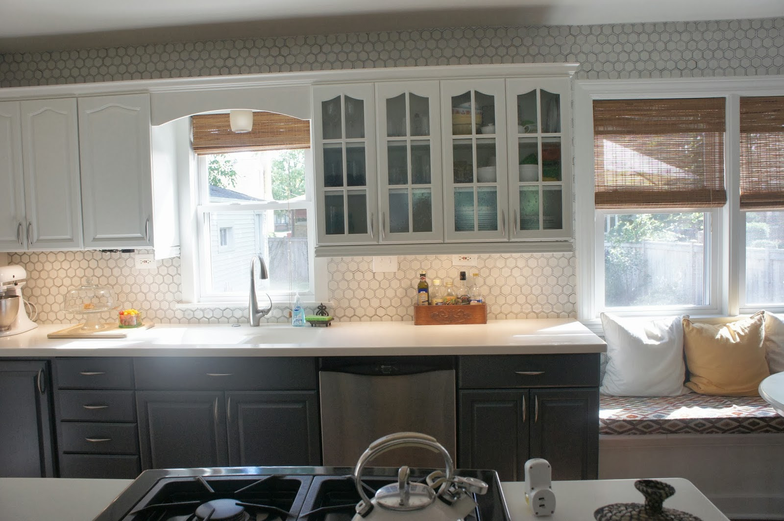 Gray Kitchen White Cabinets with Tile Backsplash