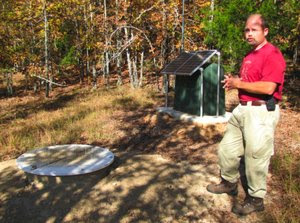 Scott Ausbrooks, the geo-hazards and environmental geology supervisor for the Arkansas Geological Survey, explains how an earthquake sensor station buried at Wooly Hollow State Park in Greenbrier works.