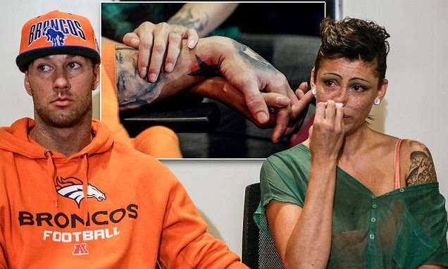 Rod Daily, left, and his girlfriend, Cameron Bay, both adult film performers who became infected with HIV while working in the adult industry, hold hands as they take questions from the media during a news conference