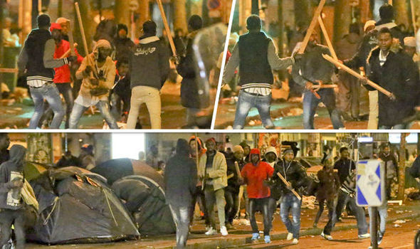 Migrants fought running battles in the streets of Paris this morning
