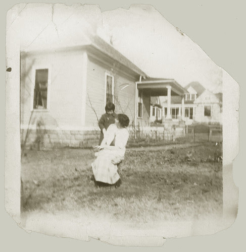 Woman and child in yard