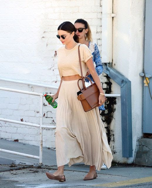 Le Fashion Blog Miranda Kerr Nude Cropped Top Nude Pleated Skirt Tan Pointed Toe Flats Via Vogue