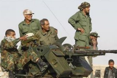 Libyan military forces mounted on a gunner outside the capital of Tripoli. The Gaddafi government has withstood six weeks of bombardment by the imperialist military units seeking to overthrow the North African state. by Pan-African News Wire File Photos