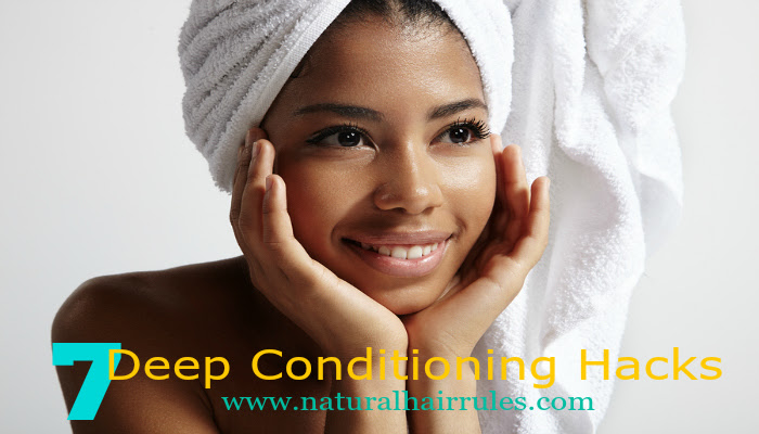 beauty young black woman with a towel on her head and wet skin