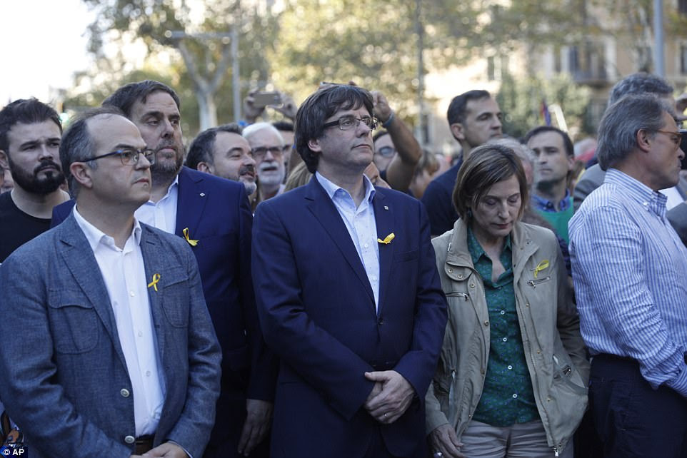 Catalan President Carles Puigdemont (third from left) takes part in a march with deputy president Oriol Junqueras (second left) and former Catalan President Artur Mas during a protest in Barcelona this afternoon