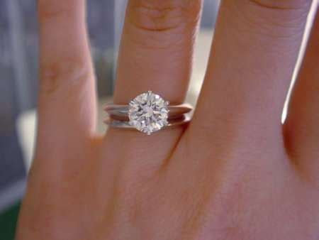 1.5 carat round solitaire with 6 white gold prongs and a