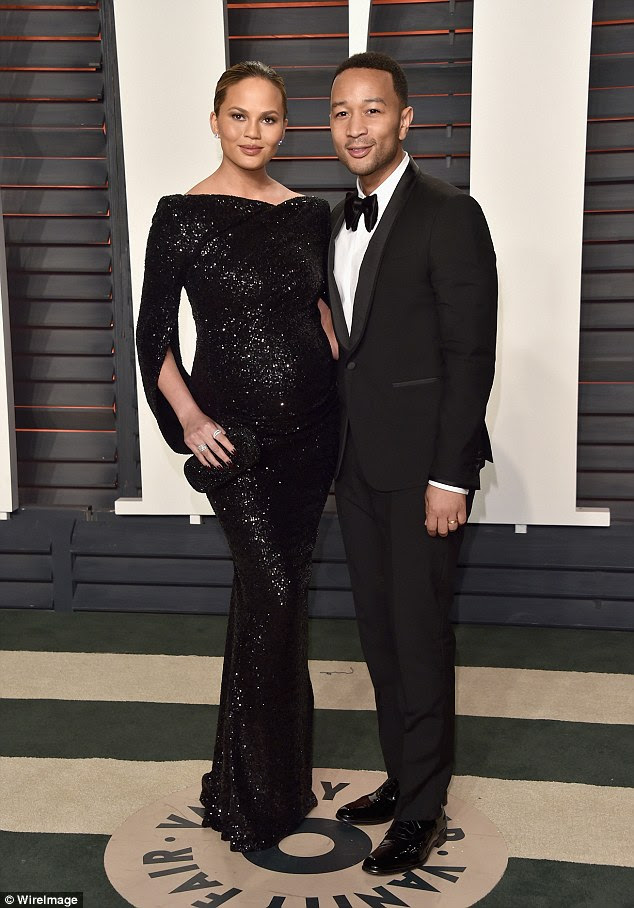 Stylish pair: Chrissy Teigen proved she was one of the most stylish pregnant stars in Hollywood as she made a quick change to attend the Vanity Fair Oscars party on Sunday night