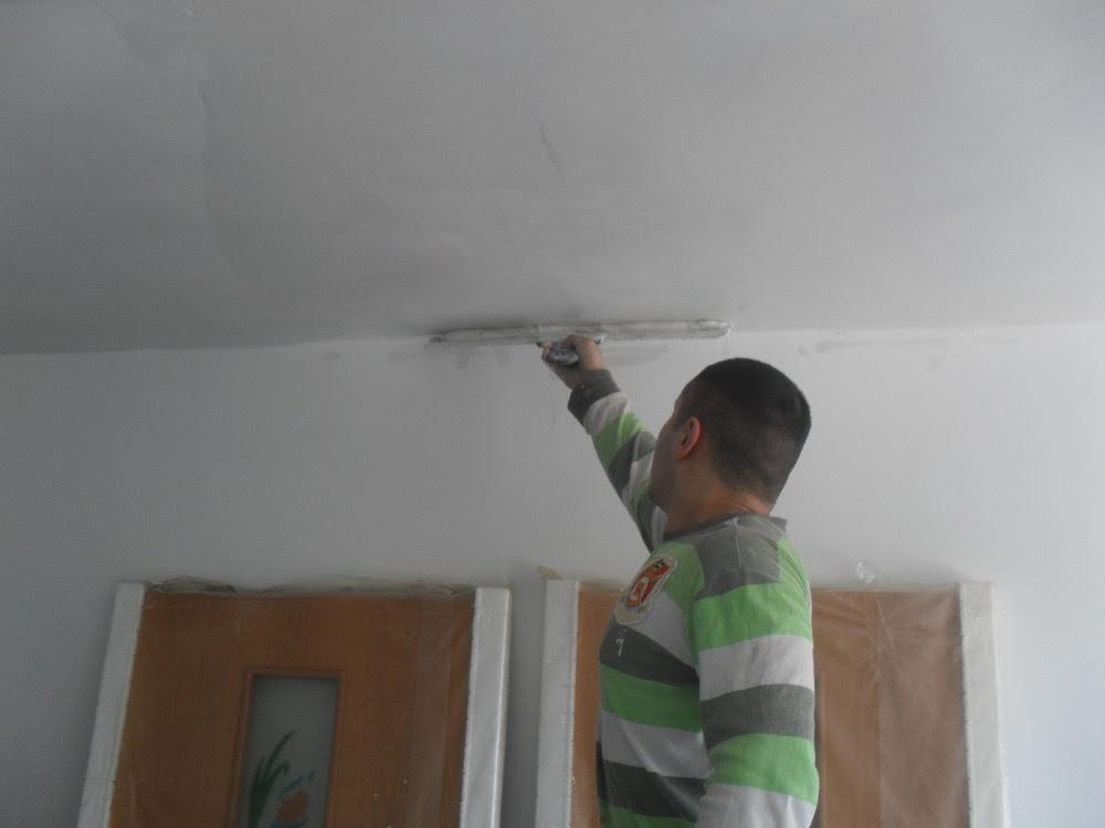 Шпатлевание стен и потолков в квартирах