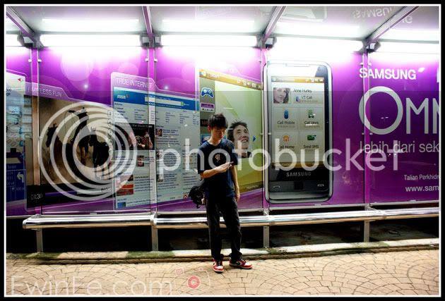 Ewin-in-front-of-bus-stop