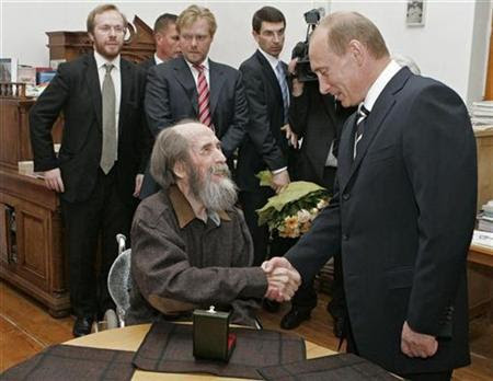 Russia's President Vladimir Putin (R) and Alexander Solzhenitsyn shake hands as president visits his home in Troitse-Lykovo in Moscow, June 12, 2007. Putin handed a State Prize for Solzhenitsyn's achievements in humanitarian field to his wife Natalia during a ceremony in Moscow's Kremlin. REUTERS/RIA Novosti/Kremlin