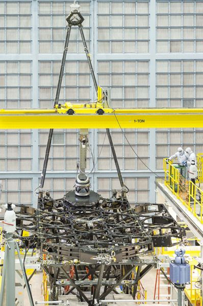 Engineers install the first of 18 mirror segments onto the James Webb Space Telescope's backplane at NASA's Goddard Space Flight Center in Greenbelt, Maryland.