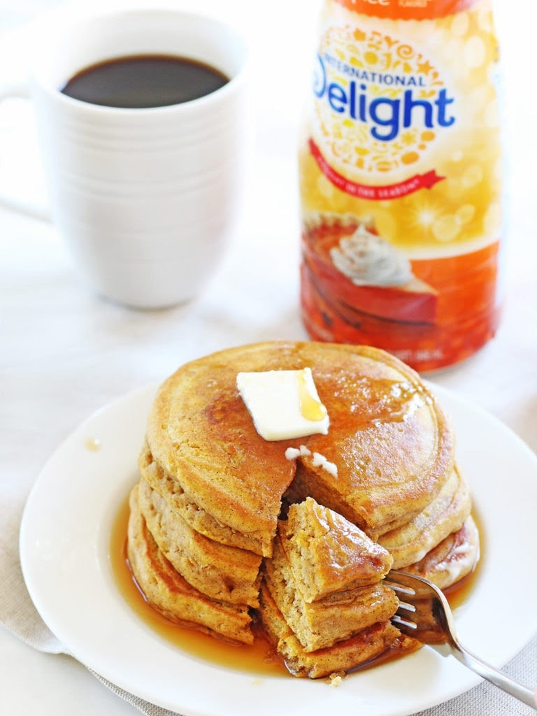 Fluffy pumpkin pancakes taste like clouds of pumpkin pie! International Delight Pumpkin Pie Spice Coffee Creamer is the secret! | www.ifyougiveablondeakitchen.com