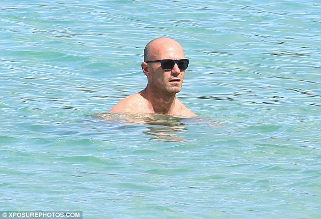 Cooling off:Alan later went for a dip in the exquisite blue waters no doubt to help cool off from the searing Caribbean sunshine