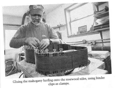 luthier using binder clips to clamp mahogany kerfing to rosewood sides