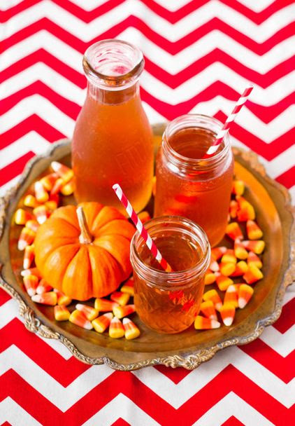Serve drinks on a tray lined with candy corn, and a mini pumpkin... use the same idea for Christmas, maybe line with Hershey kisses or Christmas M's?
